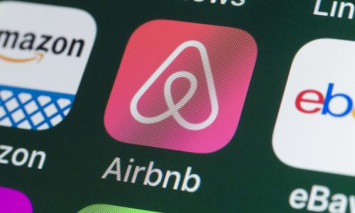 London, UK - July 31, 2018: The buttons of the travel app Airbnb, surrounded by Amazon, ebay, News and other apps on the screen of an iPhone.